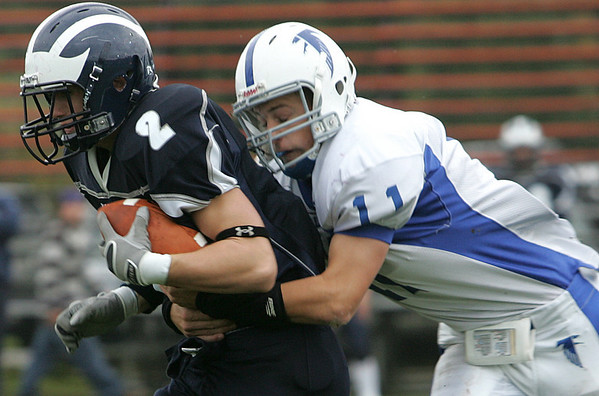 Swampscott's Randall Kelleher is tackled by Danvers' Steven Hennessey during Saturday's game held at Swampscott. Photo by Deborah Parker/October 24, 2009