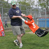 Rob Pelletier of Salem spins Brady Tremblay, 5, of Salem around following the Annual Salem Little League Parade Sunday morning. Starting at Salem State College, the parade crossed Lafayette Street and ended at Forest River Park. Photo by Deborah Parker/April 25, 2010