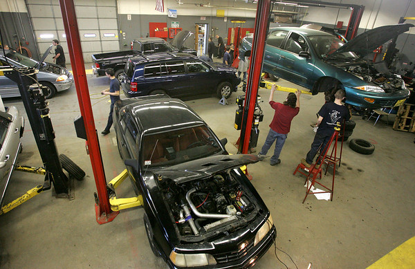 Students work in the auto shop which is part of the Peabody High Vocational School located inside Higgins Middle School. Photo by Deborah Parker/November 17, 2009