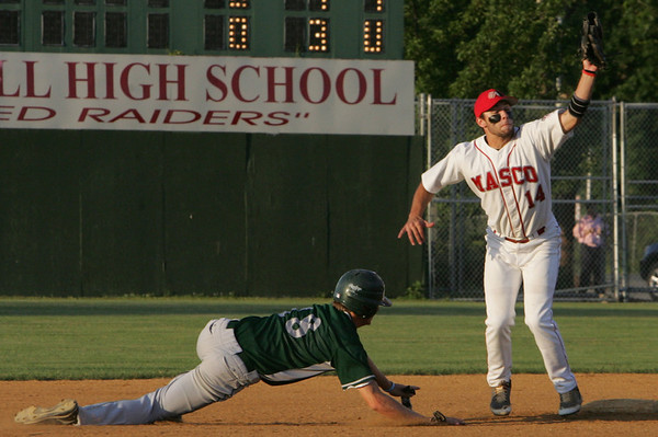 Masco's Chris Splinter makes the tag for the out against Duxbury's Steve Blout in the Eastern Massachusetts Championship State semifinals Division 2 game held at Alumni Field in Lowell Tuesday evening. Photo by Deborah Parker/June 15, 2010