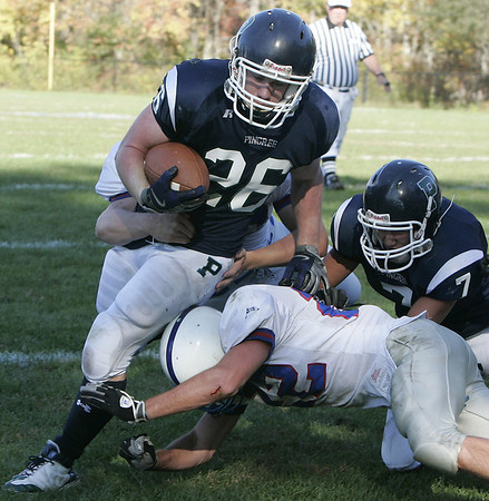 Hamilton: Pingree's Pat George is brought down by Holderness' Jack Dings during Saturday's game at Pingree.<br /> Photo by Deborah Parker/Salem News Saturday, October 11, 2008