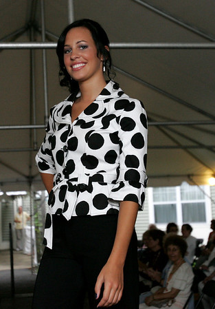 Allison Tremblay of Middleton models an outfit during Lorraine Roy Designer Collections and Bridal Boutique's Pink Pumps and Polka Dots fashion show held at Putnam Farm in Danvers Wednesday evening. Photo by Deborah Parker/August 19, 2010