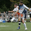 Beverly : Salem State's Paddy Boscoe and Endicott's (#26 not not on roster) fight for control of the ball during yesterday's game held at Endicott College. Photo by Deborah Parker/Salem News Saturday, September 06, 2008