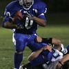 Danvers: Danvers' Eric Burgos is sacked by Peabody's Kevin Bettencourt during last night's game at Deering Stadium at Danvers High School.<br /> Photo by Deborah Parker/Salem News Friday, October 03, 2008