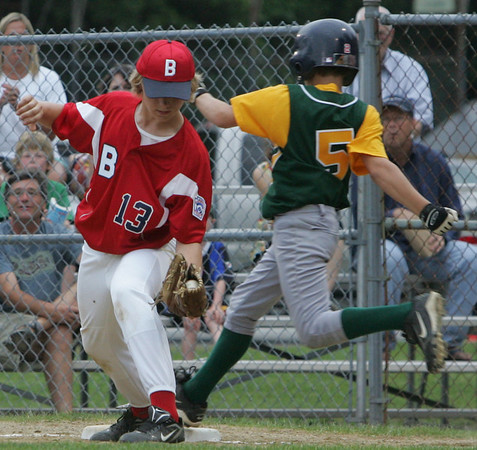 Boxford's Jake Rutstein makes the out at first against Manchester Essex's Jake Rich during yesterday's Williamsport tournament game held at Moulton Field in Danvers. Photo by Deborah Parker/June 29, 2010