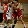 Beverly: Beverly's MIke Clayton defends against Saugus' Omar Benahicha during yesterday's game at Beverly High School. Photo by Deborah Parker/Salem News Friday, January 23, 2009.