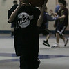 Colby Browne, 7, of Peabody, performs a lay up during a drill as part of the free youth basketball clinic in conjunction with the Tanner City Holiday Classic basketball tournament at Peabody High School Tuesday morning. photo by deborah parker/december 28, 2010