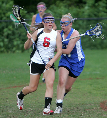 Marblehead's Jaley Braun is defended by Danvers' 21___ during yesterday's game held at Marblehead High School. Photo by Deborah Parker/May 4, 2010