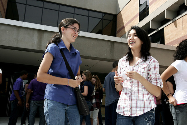 Salem High School incoming freshman, Clare Aubuchon and Vanessa Le, chat about their first day of high school following orientation Tuesday morning.  Photo by Deborah Parker/September 8, 2009