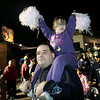Tatiana Ward waves her pom poms while on the shoulders of her dad, Dan, while talking in the Halloween Parade in downtown Salem last night. Photo by Deborah Parker/October 1, 2009