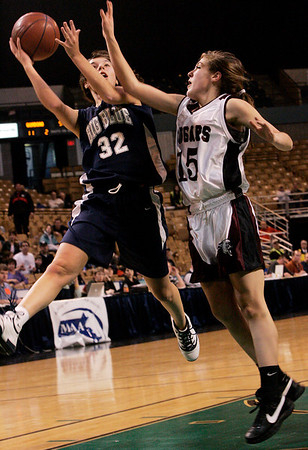Worcester: Swampscott's Kara Gilberg is defended by Quaboag's Olivia Jankins in front of the hoop during Saturday's State Finals game held at the DCU Center in Worcester. Photo by Deborah Parker/Salem News Saturday March 14, 2009.