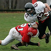 Saugus: Marblehead's Josh Freedland is tackled by Saugus' Vinny Talluto during Saturday's game held in Saugus. Photo by Deborah Parker/Salem News Saturday, November 15, 2008.