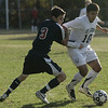Danvers: St. John's Foti Andreo keeps the ball away from Central Catholic's Liam Johnson during Saturday's game at St. John's Prep. Photo by Deborah Parker/Salem News Saturday, October 18, 2008