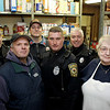 Peabody: A group of Peabody firefighters and police officers will be holding a charity hockey game to raise donations for Haven for Hunger in Peabody. Standing in the programs pantry are from left, Sergeant Vinny Patermo, Fire fighter Rick Pramas, Lieutenant Dale Kimball, Police Officer Dan Jenkins, Police Officer James Thibodeau and Haven for Hunger executive director Truby MacIntyre. Photo by Deborah Parker/Salem News Thursday, January 15, 2009.