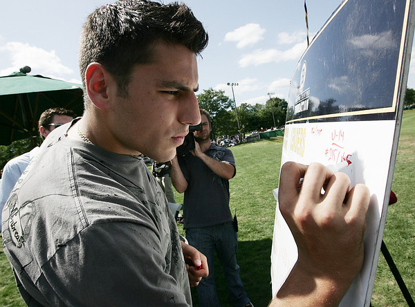 "Boston Bruins left wing Milan Lucic adjusts the leader board durin the Boston Bruins Foundation's ""Swing Like Happy Gilmore Long Drive Contest"" held at Golf Country in Middleton Tuesday.  Photo by Deborah Parker/September 1, 2009"