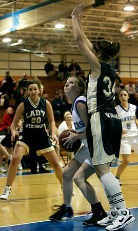 Danvers: Danvers' Ashley Conway shoots on hoop against Wintrhop's K Mallios (no first names on roster) during yesterday's game held at Danvers High School. Photo by Deborah Parker/Salem News Friday, February 6, 2009.