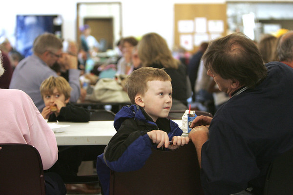 Jacob Paraquette, 5, of Ipswich chats with his grandfather Stephen Vose of Walpole during lunch at the Doyon Elementary School. This week students were invited to bring their grandparent to lunch. Photo by Deborah Parker/november 16, 2010