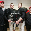 From left, head football coach Jim Rudloff, along with football players Matt Evans, Evan Comeau and 79-year-old Esso Haines pose for a photograph inside Marblehead High School. PHoto by Deborah Parker/November 19, 2009