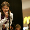 Holton Richmond sixth grade student Abby Armstrong attempts to spell a word correctly during a spelling bee held at the Liberty Tree Mall to benefit  the Danvers DEEP educational enrichment partnership Tuesday night. The event was sponsered by Danversbank. Photo by Deborah Parker/November 10, 2009