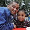 Felix Reyes of Salem poses together with his son, Christian, 7, a second grade student at the Horace Mann School in Salemduring the school's cookout Thursday evening to celebrate the start of school and the new principal Kevin Andrews. Photo by Deborah Parker/September 16, 2010<br />  , Felix Reyes of Salem poses together with his son, Christian, 7, a second grade student at the Horace Mann School in Salemduring the school's cookout Thursday evening to celebrate the start of school and the new principal Kevin Andrews. Photo by Deborah Parker/September 16, 2010