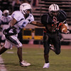 Salem:Salem's Melikke VanAlstyne outruns Peabody's Jonathan Balcacer during Saturday night's game at Bertram Field. Photo by Deborah Parker/Salem News Saturday, November 1, 2008.