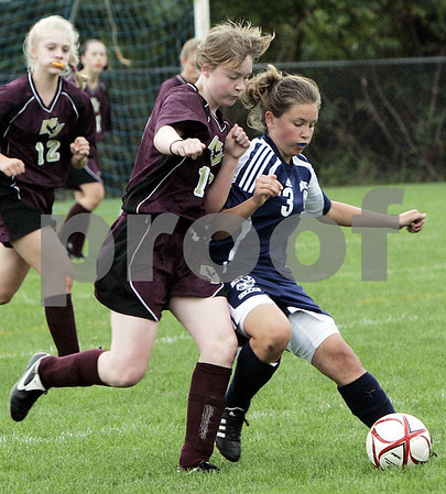 Middleton: North Shore Tech's Emily Pontes and Mystic Valley's Jade Lovett fight for control of the ball during last night's game held at North Shore Technical School. As of the first period the Bulldogs lead 1-0. This is the first time North Shore Tech has had a girls team and second game of the season.<br /> Photo by Deborah Parker/Salem News Friday, September 12, 2008