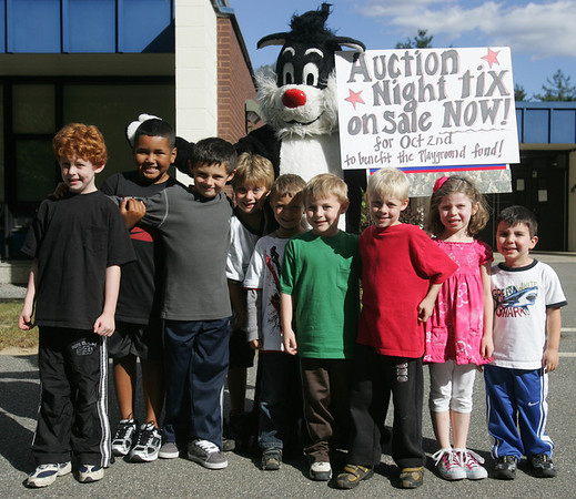 Joel Saslaw, dressed as Sylvester the Cat, along with students from Burke Elementary School in Peabody, has been trying to raise money to help build a playground for the school, which currently, does not have one. From left, Steven O'Hara, Justin Lewis, Steven Bua, Justin Saslaw, Ryan Saslaw, Vincent O'Hara, Jack O'Hara and Isabelle McCarthy, all students at Burke Elementary.Photo by Deborah Parker/September 20, 2010