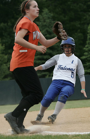 Danvers' Joanna Zecha safely slides into third base against Lowell's Meaghan Moore during yesterday's Division 1 North Semi Final game held at Martin Park in Lowell. Photo by Deborah Parker/June 4, 2009