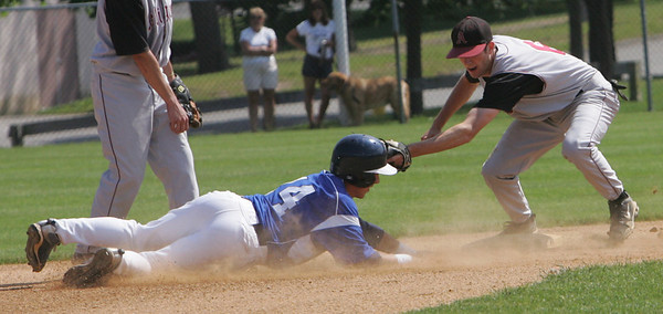 Danvers' Nick Gikas slides into second but not before being tagged by Arlington's John Powers during yesterday's Division 2 North first round state tournament game held at Twi-Field in Danvers.  Photo by Deborah Parker/June 4, 2010
