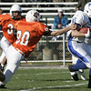 Beverly : Danvers' Colin Cooper avoids the tackle by Beverly's Mark Connors during Saturday's game at Hurd Stadium. Photo by Deborah Parker/Salem News Saturday, October 18, 2008