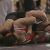 St. John's James Ingemi wrestles with Agawam's Ted Dobek during their match held at St. John's Prep in Danvers Saturday morning. photo by deborah parker/december 18, 2010