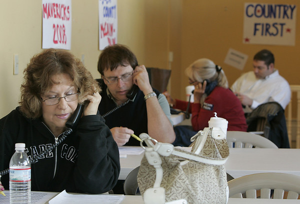 Beverly : (NOTE: woman in front didn't want her name used, so not sure she she would want to be in the paper) Volunteers work the phones Saturday while at the Republican campaign office on Cabot Street in Beverly. Photo by Deborah Parker/Salem News Saturday, October 18, 2008