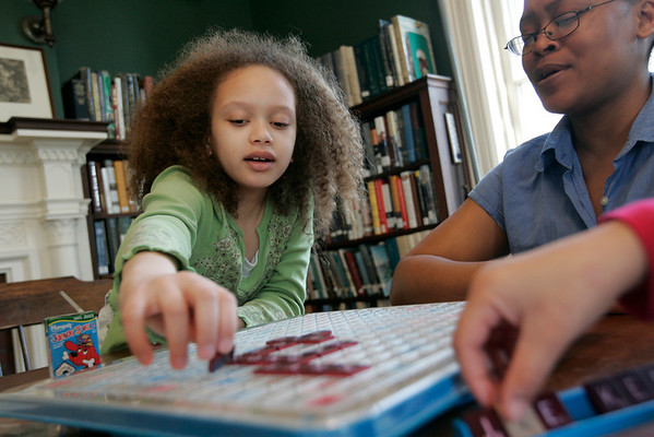 Salem: Amara Dixon, 10, of Salem asks for some help from her mom, Tara while playing scrabble against her sister, Eirene, 8, during Scrabble Tournament at the Salem Athenaeum Saturday morning. The event is one of the many that took place over the weekend as part of the Literally Salem, Salem Literature Festival. Photo by Deborah Parker/Salem News Saturday, March 28, 2009.