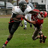 Saugus: Marblehead's Brandon Lee escapes the tackle by Saugus' Mike Dean during Saturday's game held in Saugus. Photo by Deborah Parker/Salem News Saturday, November 15, 2008.