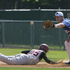 Danvers' Zack Ryan defends first base against Arlington's Kyle Hood during yesterday's Division 2 North first round state tournament game held at Twi-Field in Danvers.  Photo by Deborah Parker/June 4, 2010