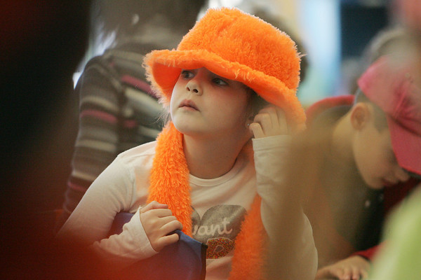 On January 28, students at the Ayer Elementary School could donated a dollar to the American Red Cross for Haiti relief and were able to wear a crazy hat to school. Here first grade student Kaylee Gillis listens in glass. Photo by Deborah Parker/January 28, 2009
