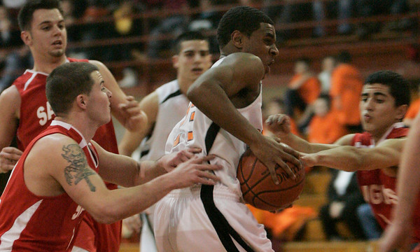 Beverly: Beverly's Mike Clayton tries to push his way through several Saugus defenders towards the hoop during yesterday's game at Beverly High School. Photo by Deborah Parker/Salem News Friday, January 23, 2009.