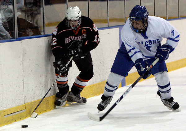Salem: Beverly's #12 fights against Danvers Kyle Larson for control of the puck during yesterday's game at Salem State's Rockett Arena. Photo by Deborah Parker/Salem News Wednesday, December 17, 2008.
