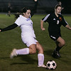 Danvers: Danvers' Allie Lea kicks the ball past Beverly's Clare Leatherstich during Thursday night's game at Deering Stadium. Photo by Deborah Parker/Salem News Thursday, September 25, 2008