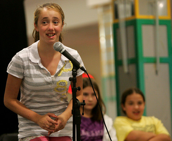 Holton Richmond sixth grade student Abby Armstrong Abby Vanne attempts to spell a word correctly during a spelling bee held at the Liberty Tree Mall to benefit  the Danvers DEEP educational enrichment partnership Tuesday night. The event was sponsered by Danversbank. Photo by Deborah Parker/November 10, 2009