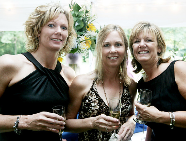 From left Anne Heutlinger, Susan Cann and Katie Pelletier, all of Danvers pose together while attending the annual Baron Mayor Champagne Reception held at the Glen Magna Farms in Endicott Park Friday evening. Photo by Deborah Parker/June 19, 2009