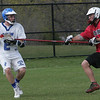 Danvers' Chris Kontos is defended near the net by Salem's James Labao during yesterday's game held in Danvers. PHoto by Deborah Parker/April 19, 2010
