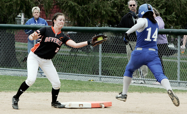 Danvers: Danvers' Shannon Kidger is too late as Beverly's Daryl Powell makes the out during yesterday's game held in Danvers. Photo by Deborah Parker/Salem News May 01, 2009