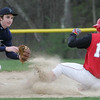 Masco's Ben Panunzie reaches the plate before the ball against Pingree's Jack Whelan during yesterday's game held at Pingree. Photo by Deborah Parker/April 12, 2010