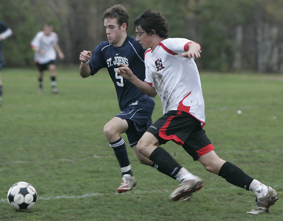 Salem: St. John's Prep's Dylan Stigliano and Salem's Mike Shea fight for control of the ball in yesterday's MIAA tournament action at Bertram Field. St. John's won the game 3-1. Photo by Deborah Parker/Salem News Friday, November 07, 2008