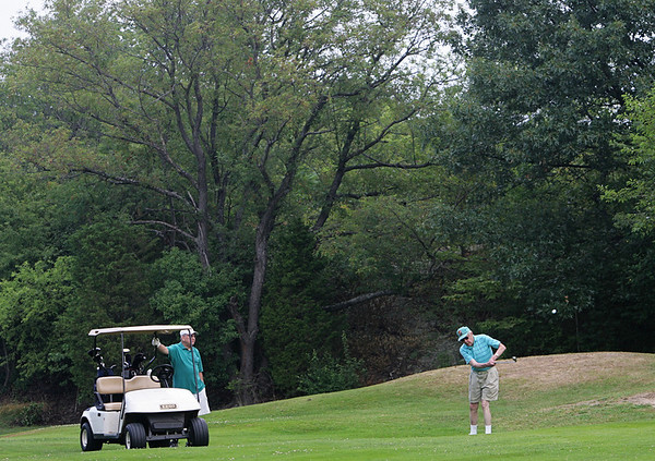 Ken Ring, is a 95-year-old golfer who still plays once a week with a group of friends at the Olde Salem Greens. Next to him is is friend, Joe Martel. Photo by Deborah Parker/July 12, 2010