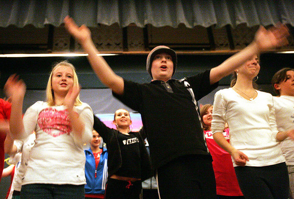 Kade Devlin, center, who plays the Wizard, dances in a scene with his classmates during rehearsal at Briscoe Middle School after school Monday. From left, Annie Mariano, Devlin and Laura Trainor Photo by Deborah Parker/January 25, 2009