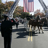 Beverly : The casket of Army Spc. Stephen Fortunato is carried into St. Mary's Cemetary Friday.<br /> Photo by Deborah Parker/Salem News Friday, October 24, 2008
