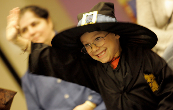 Peabody: Dressed as Harry Potter, Jack Hamilton, 7, of Peabody, excitedly raises his hand to answer a question while Officer Eon of the Peabody Police gave a short presentation on Halloween safety during a Halloween Party at the Peabody Institue Library.  Photo by Deborah Parker/ Salem News Thursday, October 30, 2008.