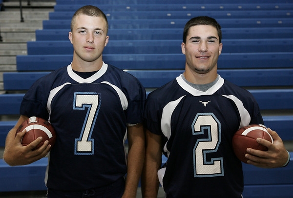 Peabody football quaterback Mike O'Brien along with running back Mark D'Addario. Photo by Deborah Parker/August 29, 2009